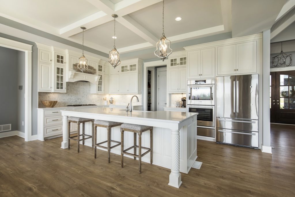 Kitchen in Grand Oaks home with large island